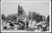 """Queen Victoria Monument, Queen's Park"" (postcard): ceremony around the queen's statue, 1910."