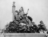 """""""IT WAS ALL HELD IN HER MEMORY"""": Statue of Queen Victoria in Queen's Park, decorated on Empire Day': Empire Day ceremony, May 24, 1913."""