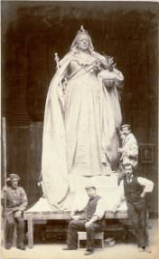 Alfred Drury and assistants in his London studio with the model of his Queen Victoria statue